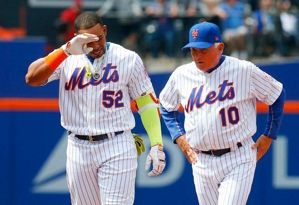 Yoenis Cespedesof the New York Mets grimaces after
