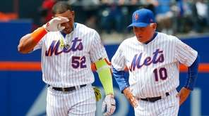Yoenis Cespedes of the New York Mets grimaces after