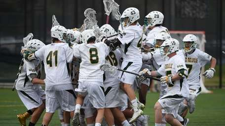 Ward Melville players mob goalie Perry Cassidy after
