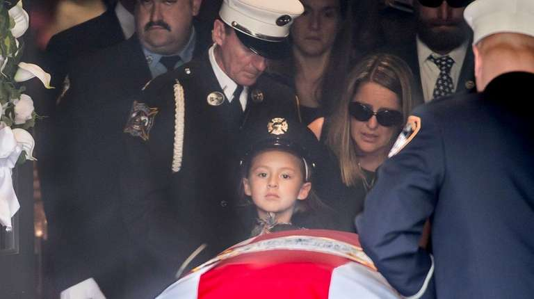 NYFD firefighter William N. Tolley's body leaving St.