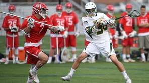 Dylan Pallonetti of Ward Melville leaps to shoot