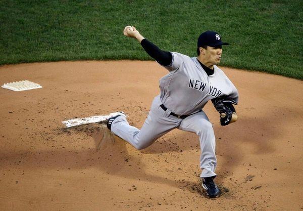 Yankees starting pitcher Masahiro Tanaka delivers to the
