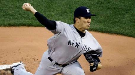 Yankees starting pitcher Masahiro Tanaka delivers to the