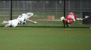 Goalie Perry Cassidy of Ward Melville and Conor