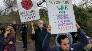 About 100 people demonstrated outside the Central Islip federal