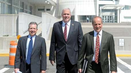 Edward Walsh, center, leaves federal courthouse in Central