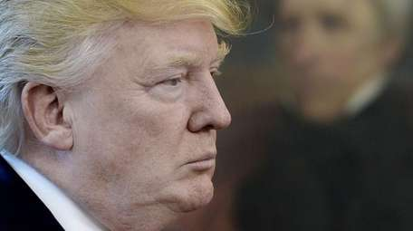 U.S. President Donald Trump looks on after speaking