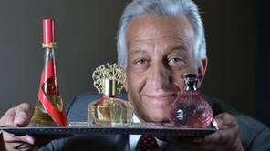 Michael Katz, CEO of Perfumania Holdings Inc., holds