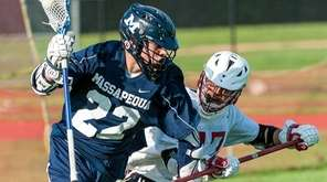 Massapequa's  Brendan Nichtern, left, goes against Syosset's Steven