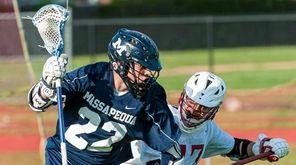 Massapequa's Brendan Nichtern, left, controls the ball past