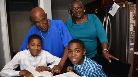 Melissa and Nathan Webb with their grandsons, fifth-grader