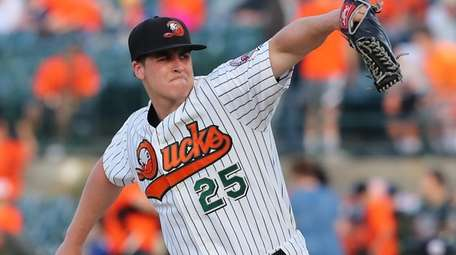 Ducks starting pitcher Keith Couch winds up during