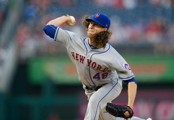 Mets starting pitcher Jacob deGrom delivers during