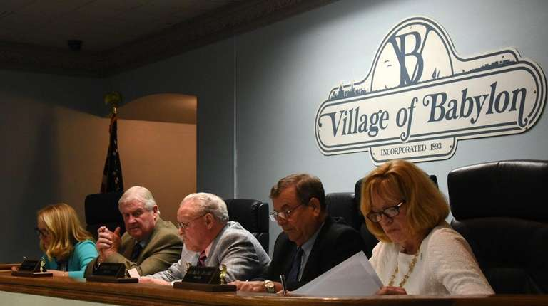 The Babylon Village board of trustees, from left: