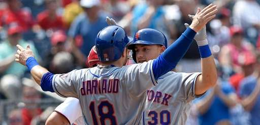 New York Mets' Michael Conforto (30) celebrates his