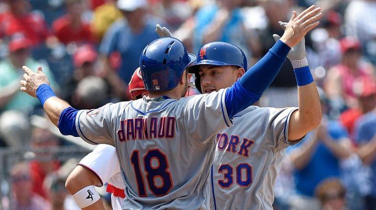 New York Mets' Michael Conforto (30) celebrates his