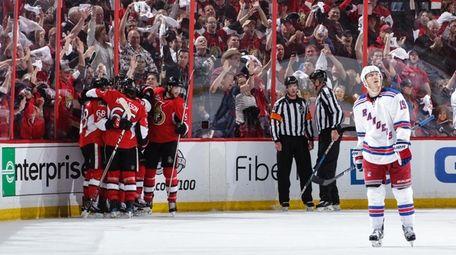 Jean-Gabriel Pageau #44 of the Ottawa Senators celebrates