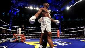 Anthony Joshua reacts after knocking down Wladimir Klitschko