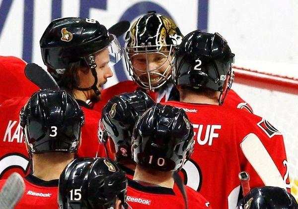 Ottawa Senators goalie Craig Anderson, top center, celebrates