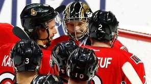 Ottawa Senators goalie Craig Anderson, top center, celebrates