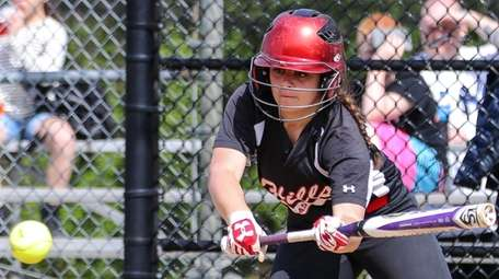 Half Hollow Hills East's Angela Scurti goes for