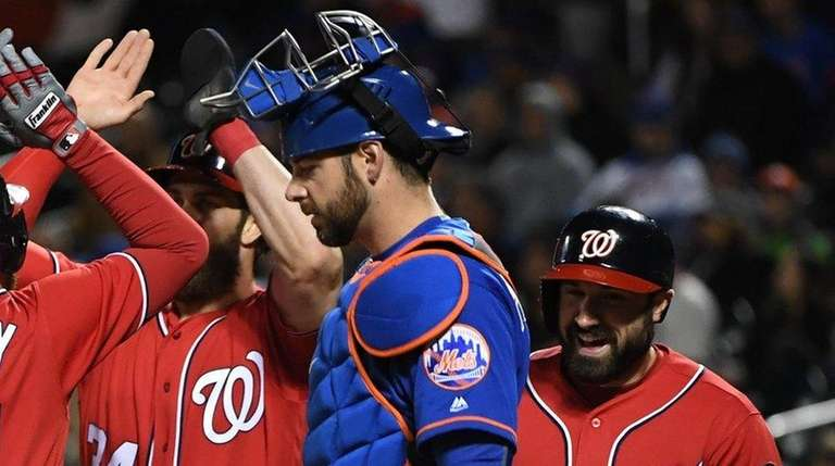 Washington Nationals second baseman Daniel Murphy is met