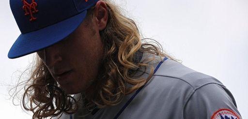 Noah Syndergaard of the Mets walks off