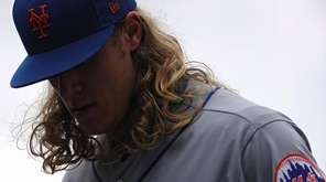 Noah Syndergaard of the Mets walks off