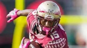 Florida State wide receiver Travis Rudolph (15) sheds