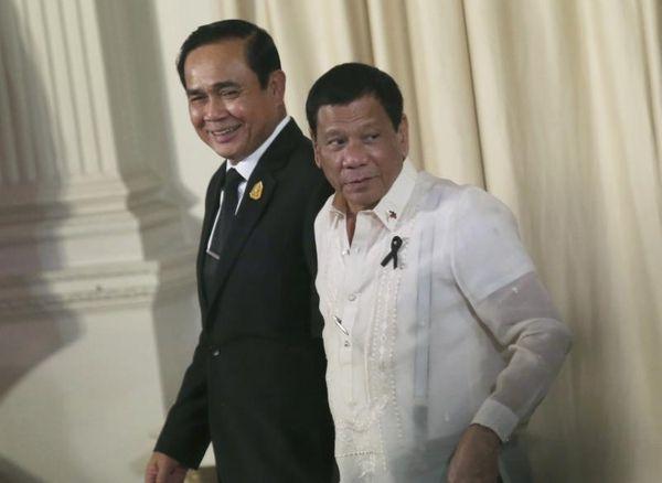 Thailand's Prime Minister Prayuth Chan-ocha, left, and Philippine