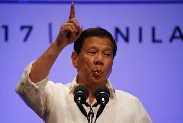 Philippines President Rodrigo Duterte gestures while addressing the