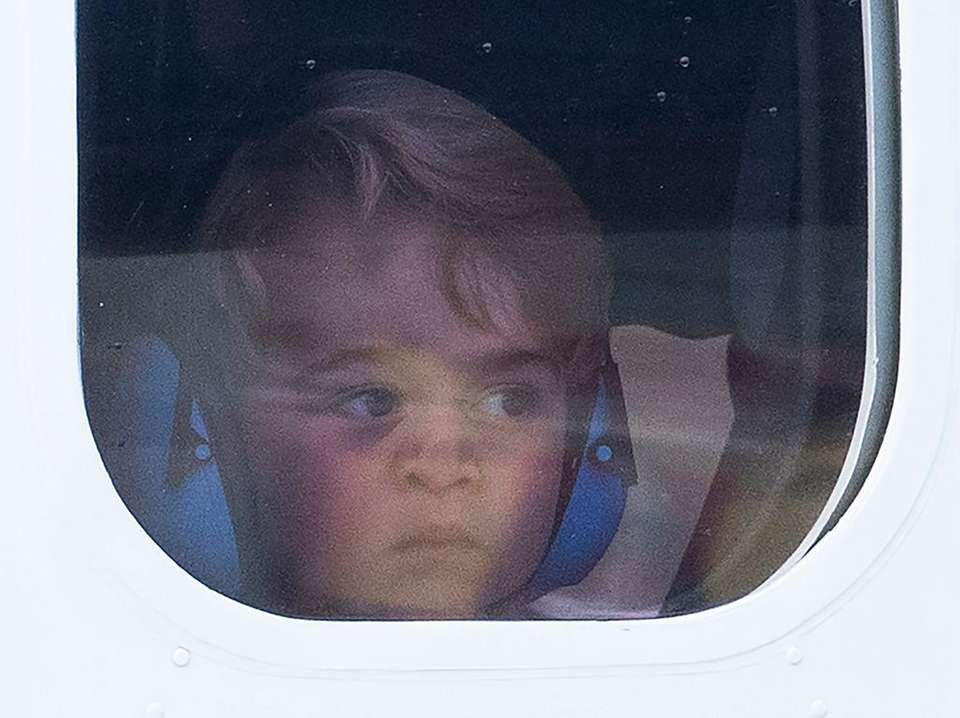 Prince George of Cambridge presses his face against