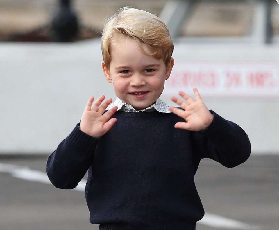 Prince George of Cambridge waves as he leaves