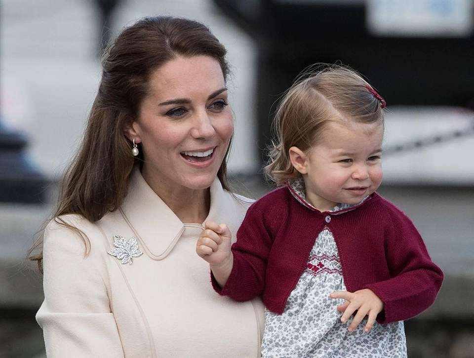 Catherine, Duchess of Cambridge and Princess Charlotte leave
