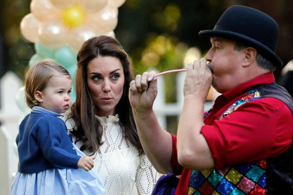 Catherine, Duchess of Cambridge, and Princess Charlotte watch
