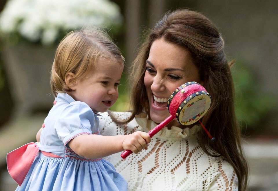 Kate, Duchess of Cambridge, smiles at Princess Charlotte