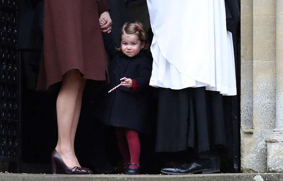 Princess Charlotte of Cambridge leaves following the service