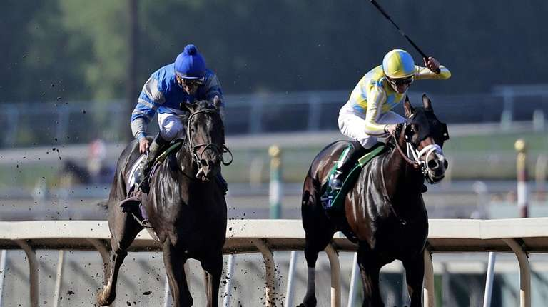 Classic Empire, right, with Julien Leparoux aboard, charges
