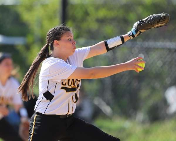 Commack's starting pitcher Kelly McKenna #11 winds up