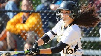 Commack's Gianna Venuti #16 smacks a base hit