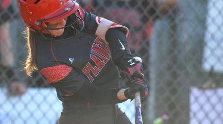 Plainedge shortstop, Jackie Mahlmeister connects for a
