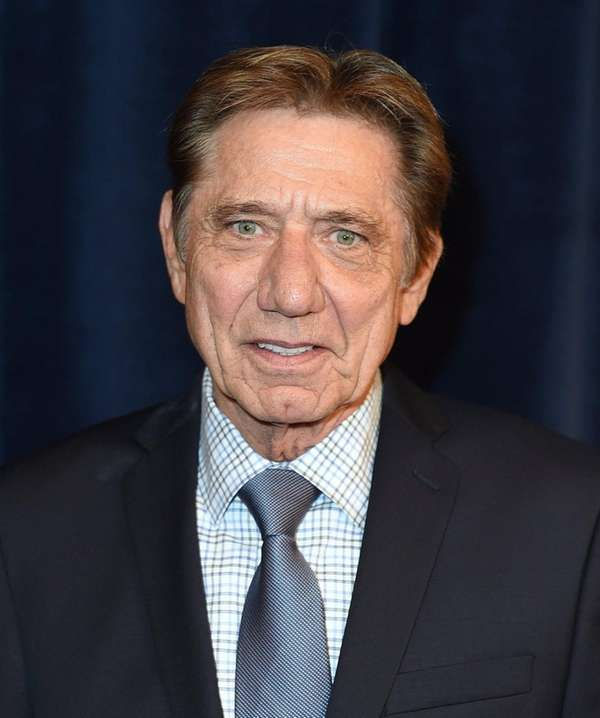 Former NFL player Joe Namath poses backstage at