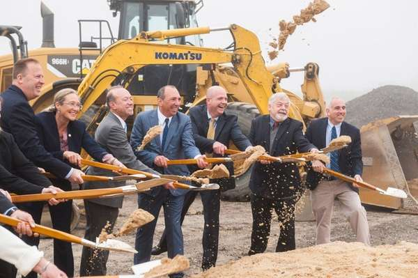 Officials participate in a groundbreaking ceremony for an