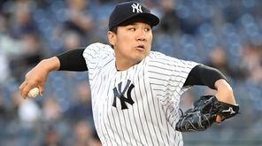 New York Yankees starting pitcher Masahiro Tanaka delivers