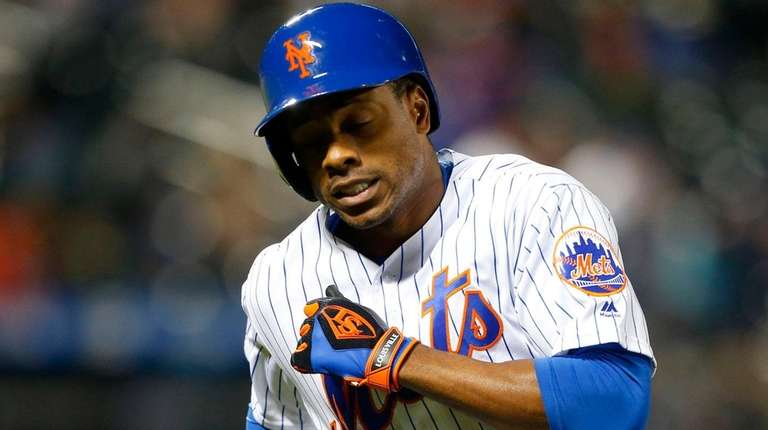 Curtis Granderson of the Mets reacts after flying