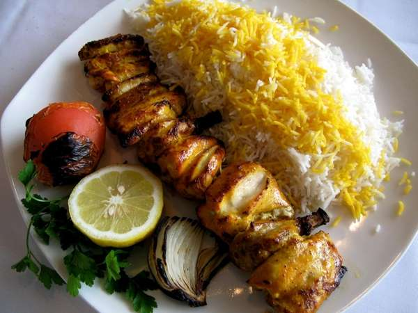 Jujeh kebab (bone-in lemon-saffron guinea hen) is on