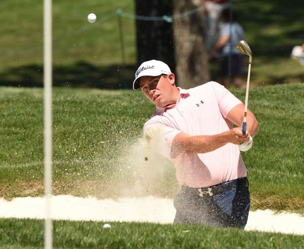 Scott Stallings chips onto a practice green from