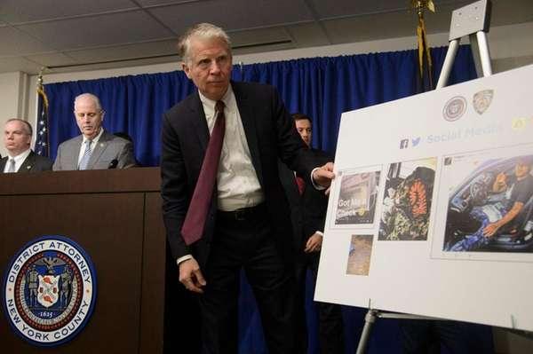 NYPD Chief of Detectives Robert Boyce, adjusts a