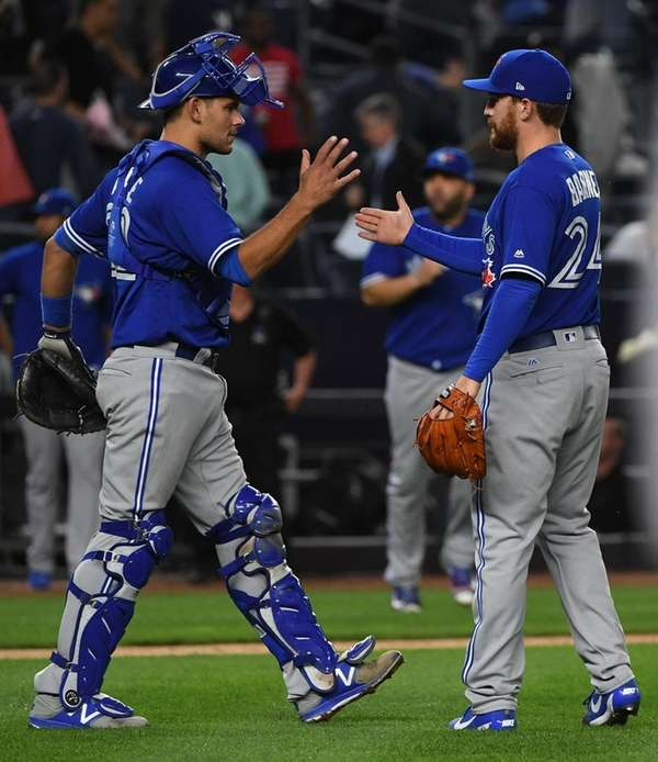 Toronto Blue Jays catcher Luke Maile and relief