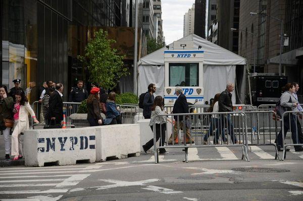 People walk the security along Fifth Avenue adjacent
